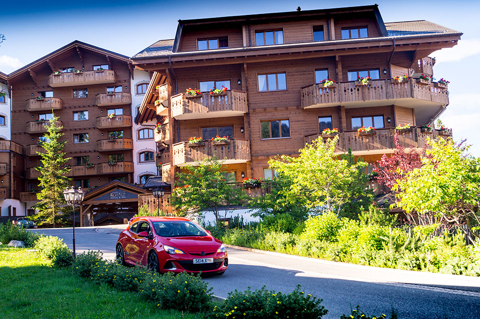 Red Vauxhall Astra VXR in the Swiss Alps