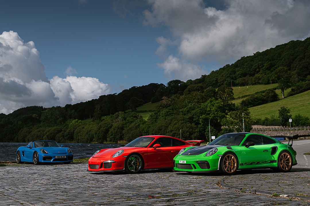Green and Red Porsche 911 GT3, Blue Porsche Boxster Spyder